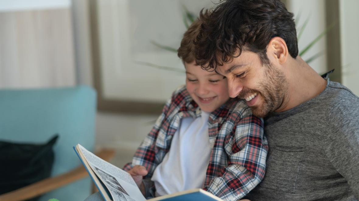 father and son reading a picture book together