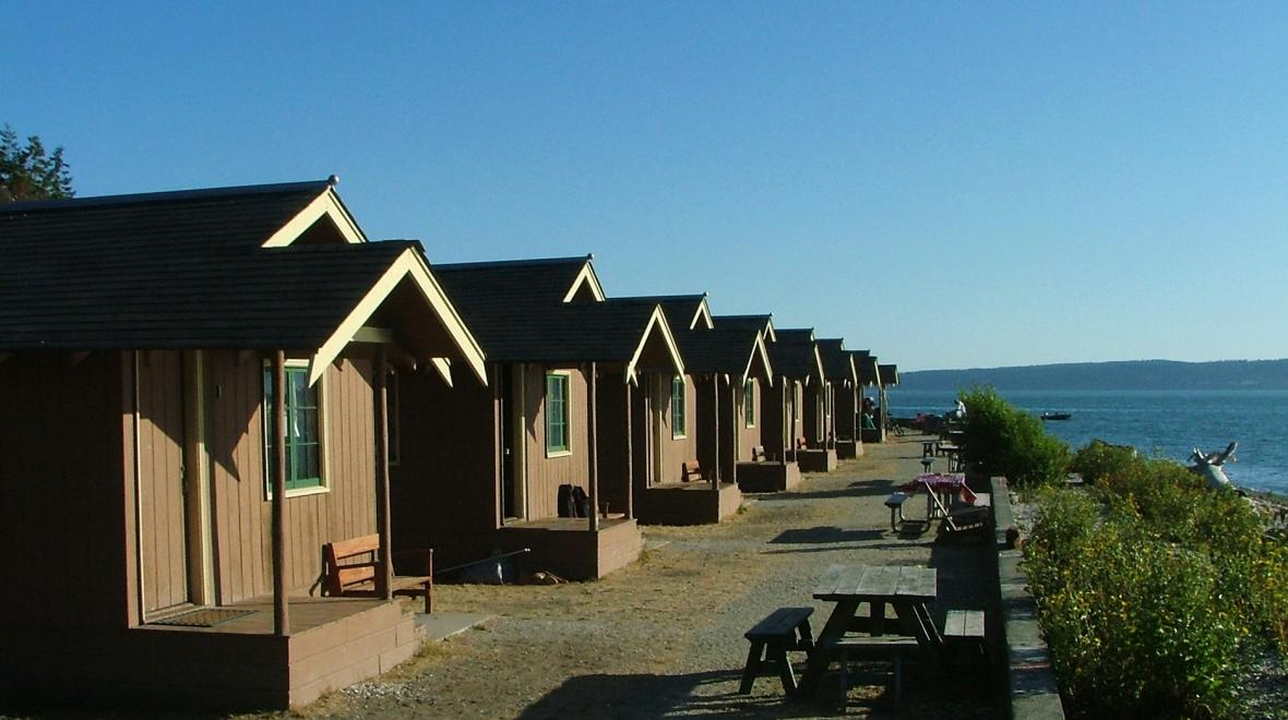 Rows of cabins at Cama Beach State Park on Camano Island, Wash., best cabins for Seattle families with kids