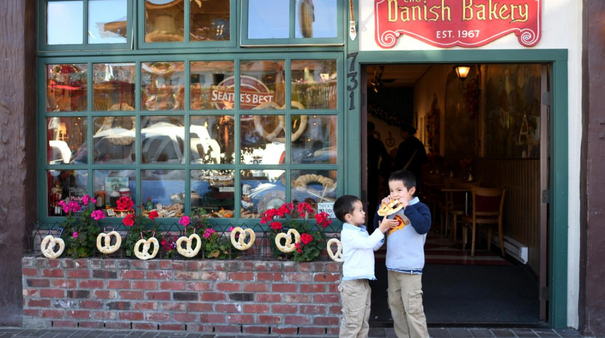 Boys having a snack in front of Leavnworth's Danish Bakery nearby getaways for Seattle-area families