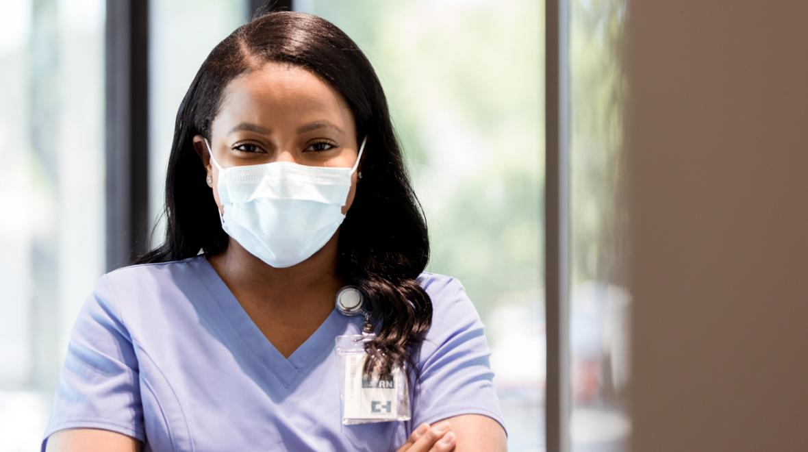 black nurse wearing a mask