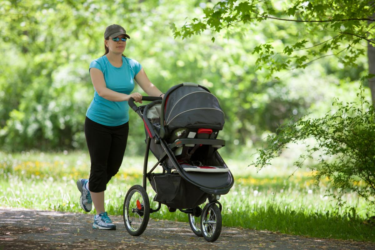 Woman%20mom%20with%20stroller%20walking%20spring%20istock 0