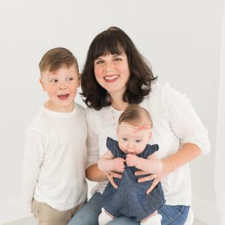 Image of dark-haired smiling woman, ParentMap writer Lisette Wolter-McKinley, along with her kids, a young boy and baby girl