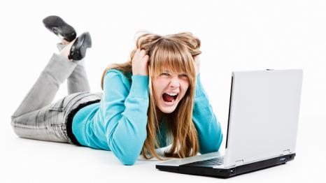 Stressed out teenager girl with computer