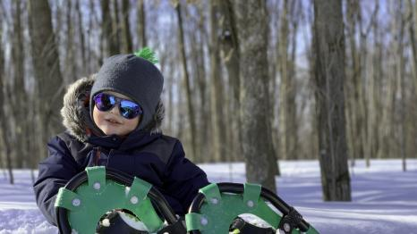 Boy-in-sunglasses-snowshoes-snow-family-snowshoeing-guide-tips-getting-started