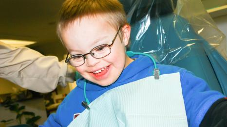 Cute boy who has special needs has a dental appointment