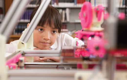 Girl watching 3D printer