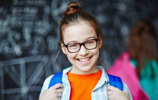 Girl in glasses with backpack
