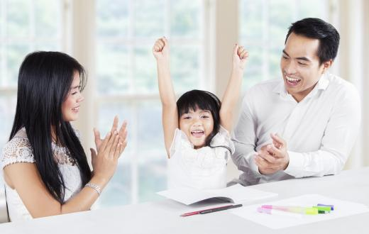 Young girl celebrating with her mom and dad