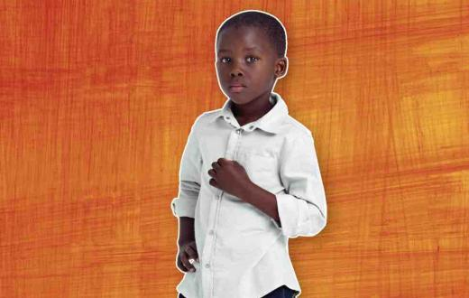Little black boy against orange background