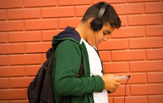Teenage boy listening to headphones
