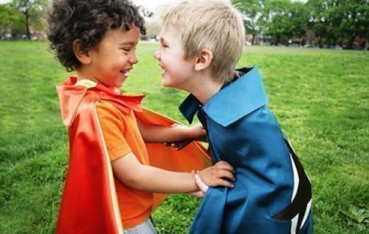 Two little boys in capes