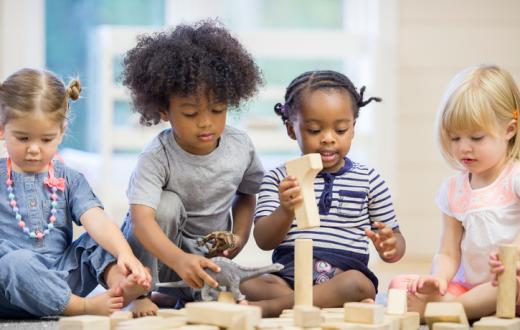 Preschool kids playing with blocks