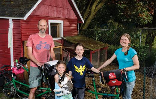 Family with chicken and bike