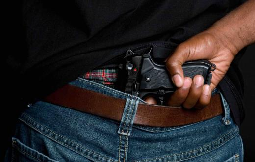 Gun hidden in waistband of jeans