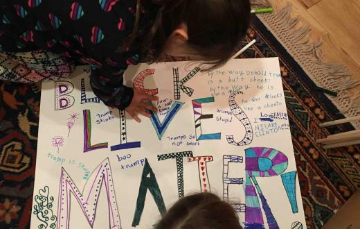 Natalie Singer-Velush's daughters creating a Black Lives Matter poster