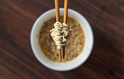 Ramen bowl with noodles and chopsticks