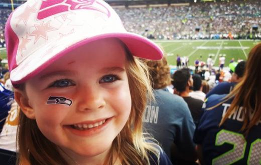 Smiling girl at Seahawks game