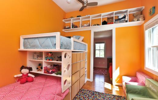 Storage solutions in orange bedroom