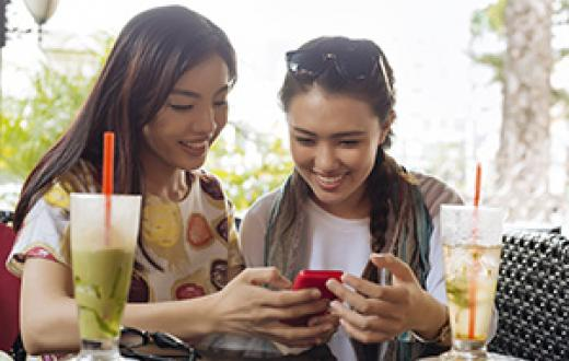 Two teen girls looking at a phone