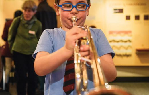 A young musician practices at the Seattle Symphony