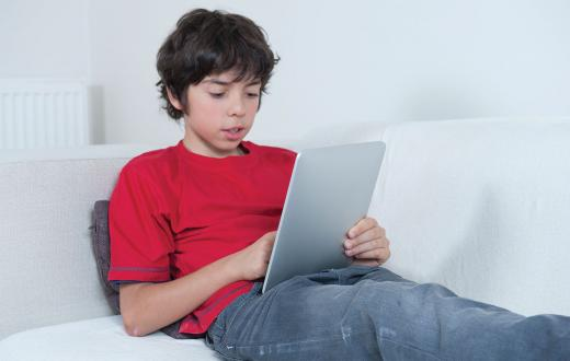 Tween boy using a tablet