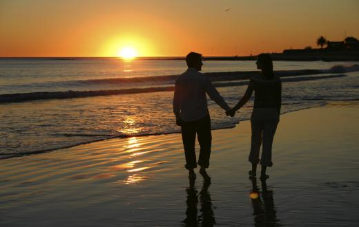 Couple hand-in-hand on the beach