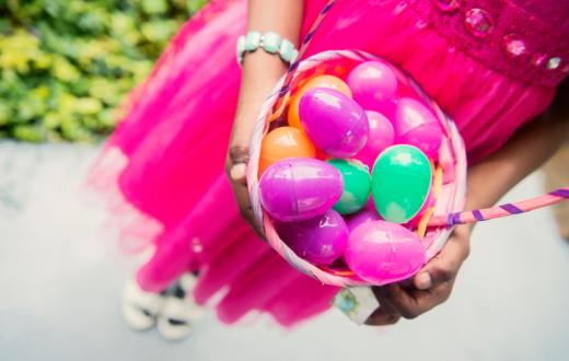 Girl holding Easter basket with eggs