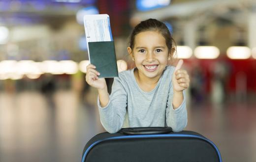Child with suitcase in airport