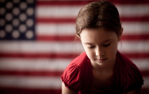Girl with American flag in background