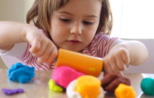 Girl playing with play-dough