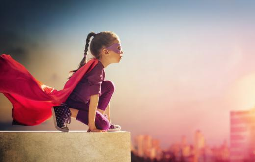 Girl superhero on ledge