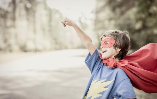 Boy dressed as superhero