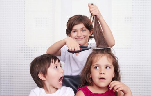 Three kids getting hair cut
