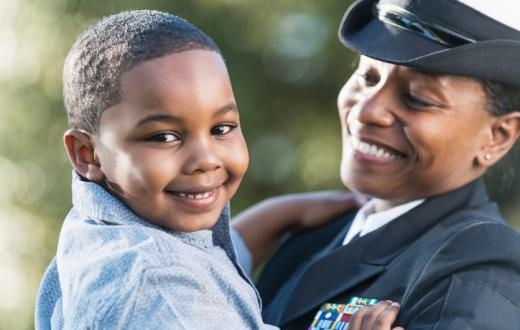 Kid with mom in Navy uniforn