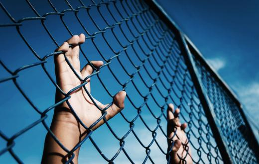 child-clutching-fence