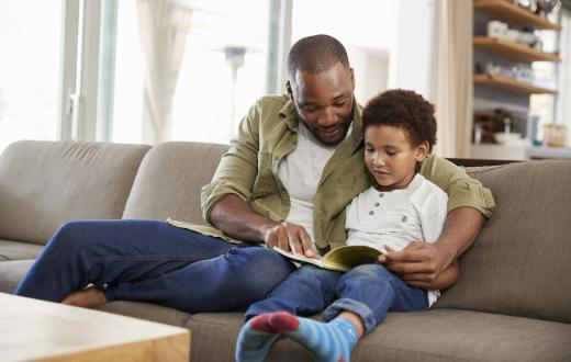 black father and son reading together