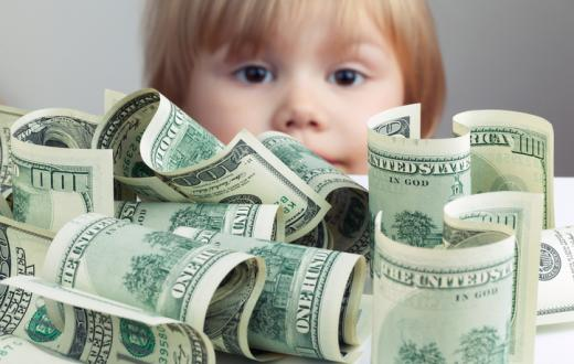 Toddler with cash