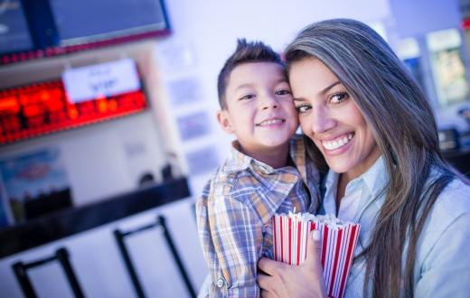 mother and son at movie theater