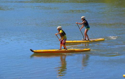 Kids stand-up paddleboarding