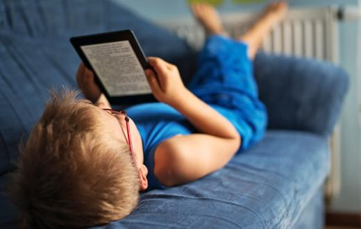 Child on eReader