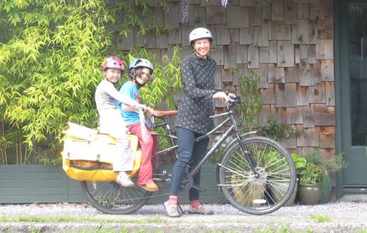 Mom toting kids on bike