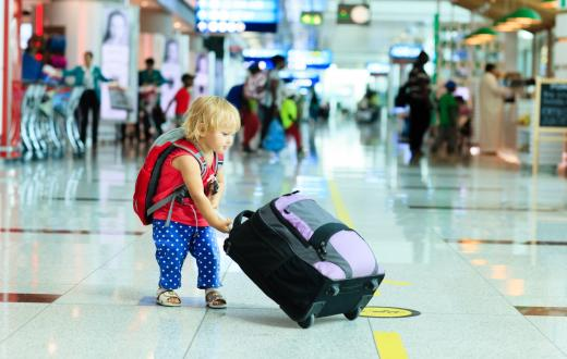 Toddler with luggage in the airport
