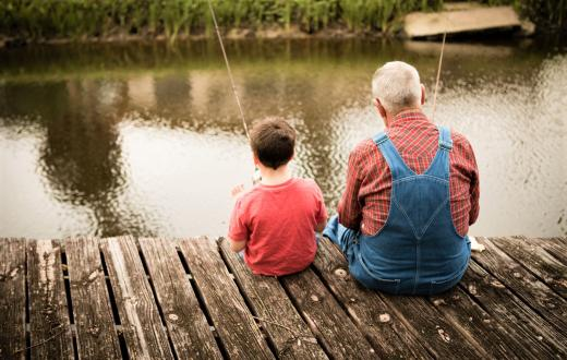 boy and grandpa fishing off dock