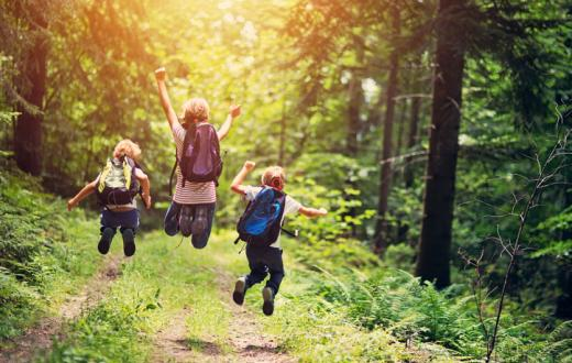 Kids jumping on hike