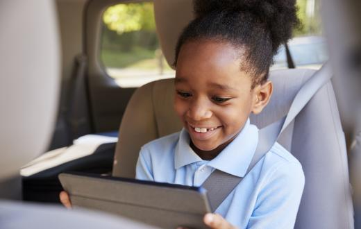 kid using ipad app in the car