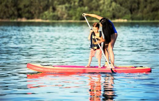 Boy and mom stand-up paddleboarding