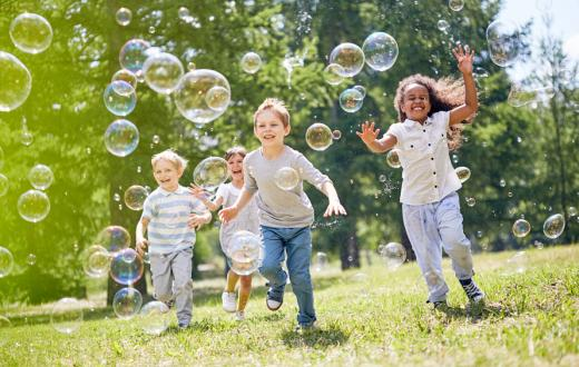 kids playing outside with bubbles