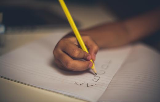 Child handwriting with pencil