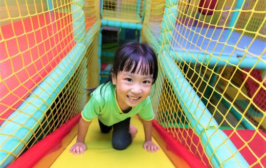 girl playing in indoor play gym