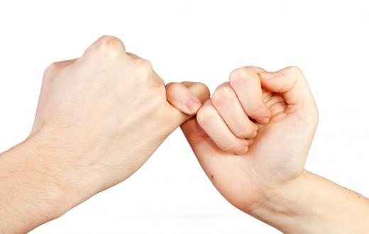 Two moms share a pinky swear